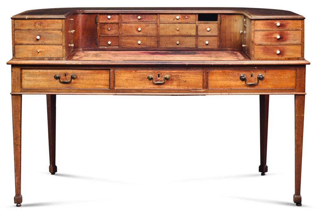 A REGENCY MAHOGANY CARLTON HOUSE DESK, CIRCA 1803, AFTER A DESIGN BY GEORGE HEPPLEWHITE