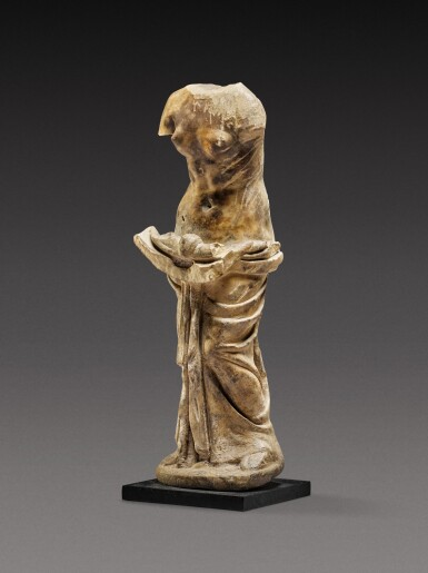 View 2. Thumbnail of Lot 83. A Roman Marble Figure of a Nymph holding a Shell , circa 2nd Century A.D..