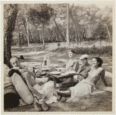 View 1. Thumbnail of Lot 14. Picnic, Mougins (Nusch and Paul Eluard, Roland Penrose, Man Ray and Ady Fidelin).