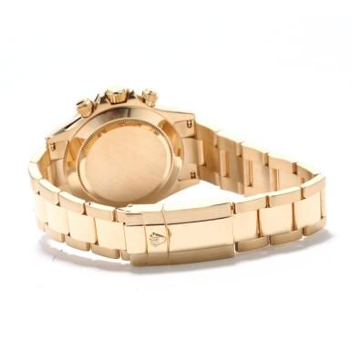 View 2. Thumbnail of Lot 9. ROLEX | Daytona, Ref 116528 A Yellow Gold Chronograph Wristwatch with Bracelet Circa 2001.