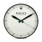 THE OHIO ADVERTISING DISPLAY CO. FOR ROLEX | REFERENCE G-062, A LARGE BLACKENED METAL WALL CLOCK, CIRCA 1965