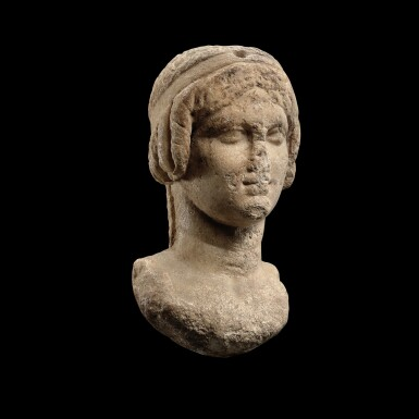 View 2. Thumbnail of Lot 62. A Ptolemaic Marble Head of a Queen in the guise of Isis, circa 2nd Century B.C..