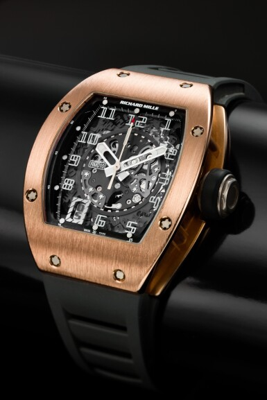 View 1. Thumbnail of Lot 191. RM010 A PINK GOLD CURVED TONNEAU SEMI-SKELETONIZED AUTOMATIC CENTER SECONDS WRISTWATCH WITH DATE, CIRCA 2012.