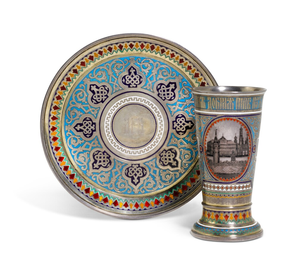 A SILVER-GILT, CHAMPLEVÉ ENAMEL AND NIELLO BEAKER AND UNDERPLATE, PAVEL OVCHINNIKOV, MOSCOW, 1876