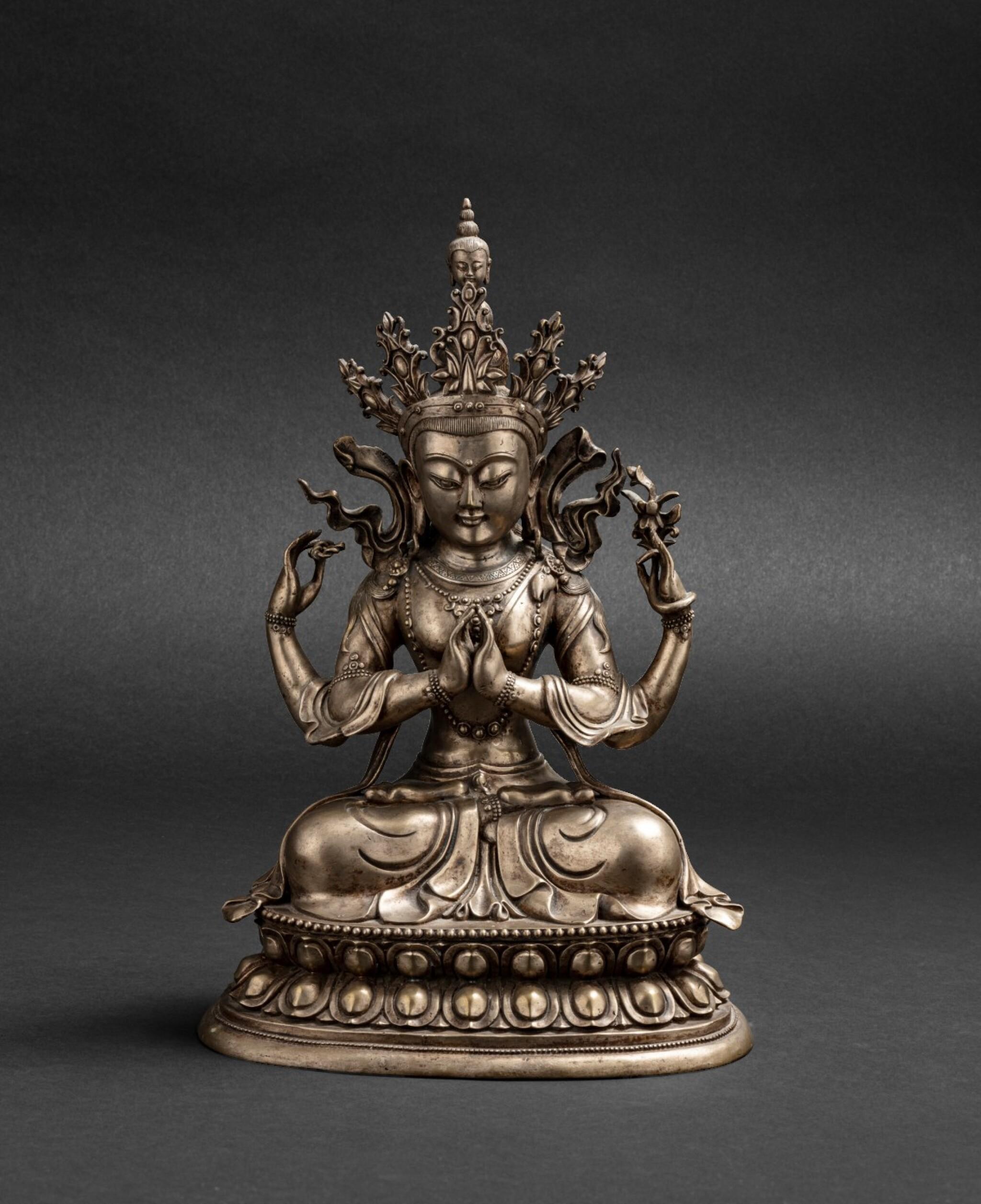 View 1 of Lot 56. Grande figure d'Avalokiteshvara en bronze argenté Circa 1900 | 約1900年 鎏銀銅觀世音菩薩座像 | A silvered-bronze figure of Avalokiteshvara, ca. 1900.