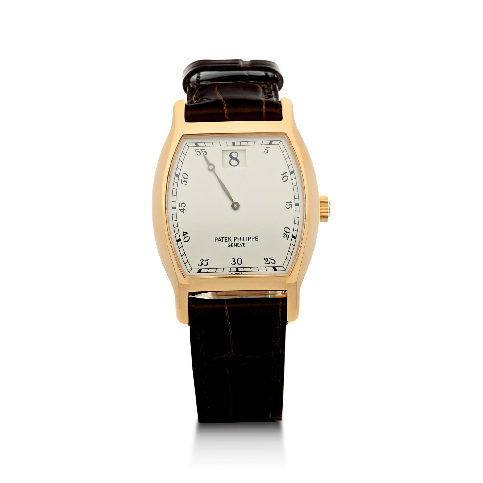 View full screen - View 1 of Lot 168. PATEK PHILIPPE   REFERENCE 3969  A LIMITED EDITION TONNEAU SHAPED PINK GOLD JUMP HOUR WRISTWATCH, MADE TO COMMEMORATE THE 150TH ANNIVERSARY OF PATEK PHILIPPE, MADE IN 1989.