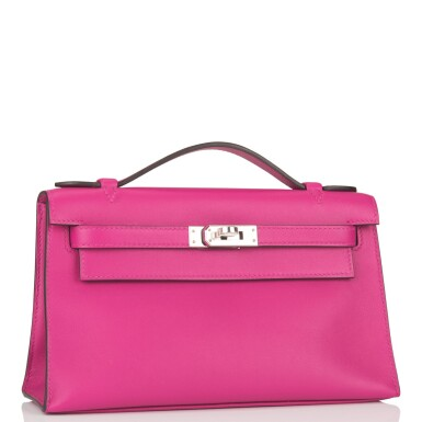 View 2. Thumbnail of Lot 16. Hermès Rose Pourpre Mini Kelly Pochette of Swift Leather with Palladium Hardware.