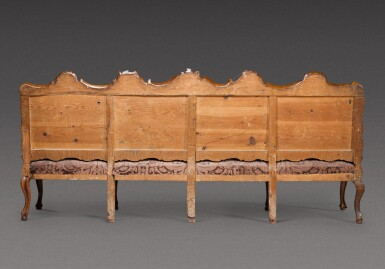 View 3. Thumbnail of Lot 177. A North Italian carved walnut sofa, probably Parma, mid-18th century.