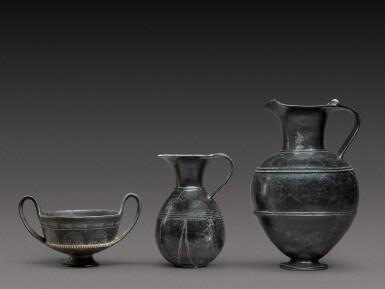 View 1. Thumbnail of Lot 37. Three Etruscan Bucchero-Ware Vessels, 7th/6th Century B.C..