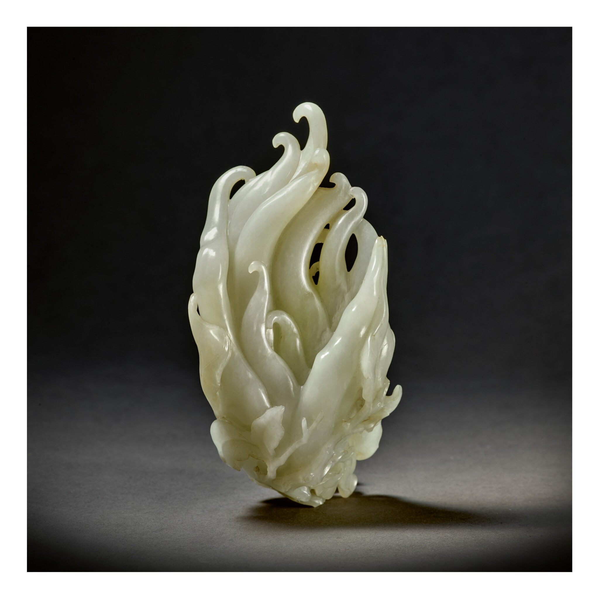 View full screen - View 1 of Lot 205. A PALE CELADON JADE CARVING OF A FINGER CITRON,  QING DYNASTY, QIANLONG PERIOD .