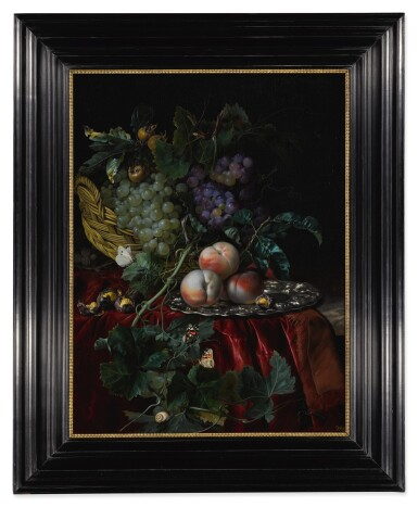 View 2. Thumbnail of Lot 36. Still life with grapes in a basket, peaches on a silver dish, medlars, two butterflies, a fly and a snail, all on a red velvet cloth over a partially draped ledge.