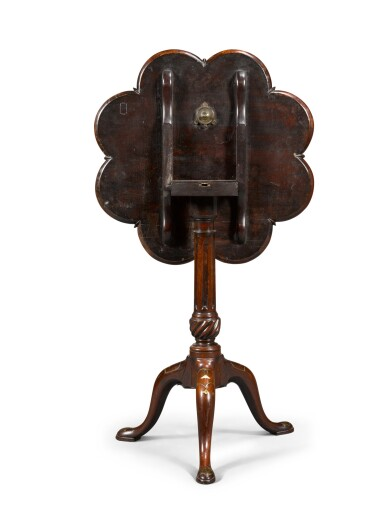 View 2. Thumbnail of Lot 66. A George III brass and mother-of-pearl inlaid mahogany supper table, circa 1760, in the manner of Frederick Hintz.