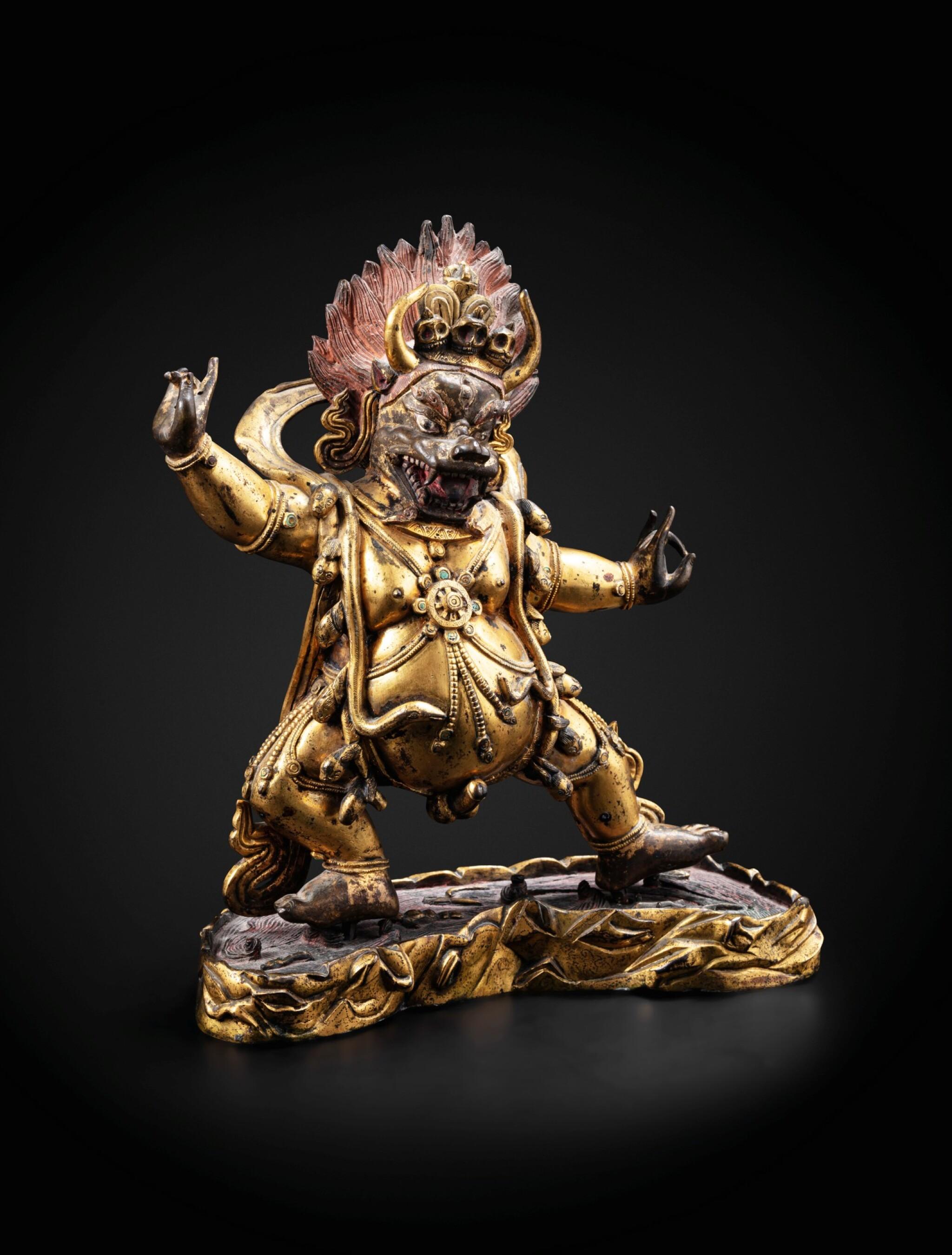 View full screen - View 1 of Lot 28. A large gilt-bronze figure of Yama Dharmaraja Qing dynasty, 18th century   清十八世紀 鎏金銅閻摩法王立像.