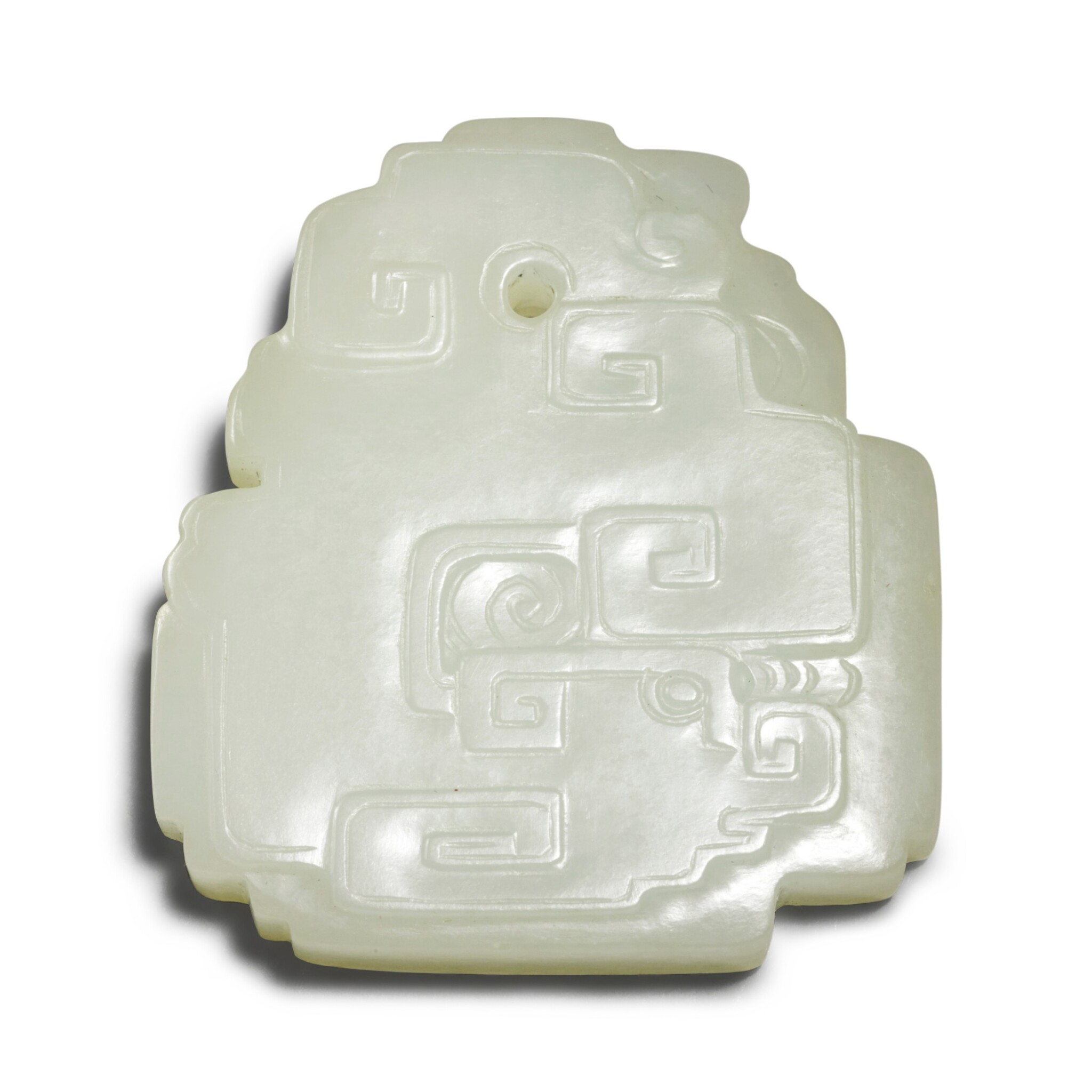 View full screen - View 1 of Lot 157. A pale celadon jade archaistic pendant, Qing dynasty.