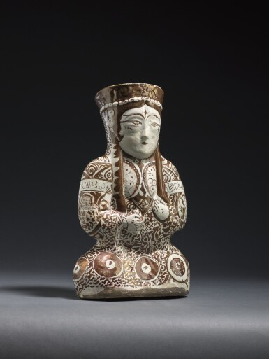 View 6. Thumbnail of Lot 212. A KASHAN LUSTRE POTTERY VESSEL IN THE FORM OF A SEATED FEMALE RULER, PERSIA, 12TH/13TH CENTURY .