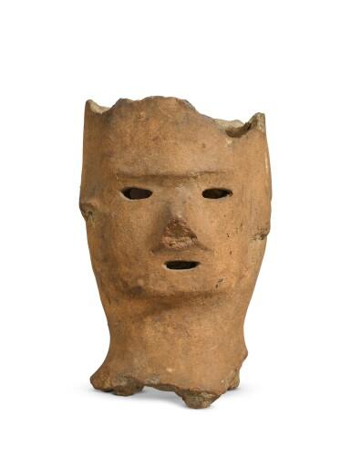 LATE KOFUN PERIOD, 6-7TH CENTURY | A HANIWA MODEL OF A HEAD