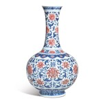 A FINE AND EXCEPTIONALLY RARE UNDERGLAZE-BLUE AND COPPER-RED 'LOTUS' BOTTLE VASE,  QIANLONG SEAL MARK AND PERIOD