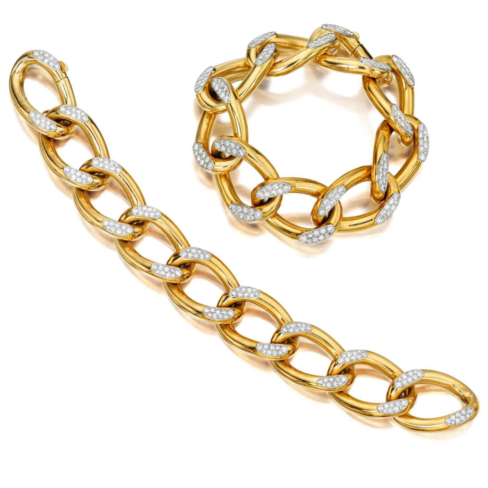 View full screen - View 1 of Lot 230. Pair of Gold and Diamond Bracelets, France.