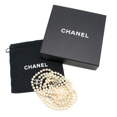 View 3. Thumbnail of Lot 165. CHANEL | IVORY FAUX PEARL DOUBLE STRAND NECKLACE WITH FAUX PEARL EMBELLISHED CC PENDANTS AND LOBSTER CLASP CLOSURE, 2012.