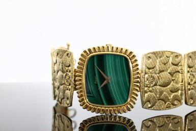 View 9. Thumbnail of Lot 66. PIAGET | REFERENCE 9431 B72 A YELLOW GOLD CUSHION SHAPED BRACELET WATCH WITH MALACHITE DIAL, CIRCA 1971.