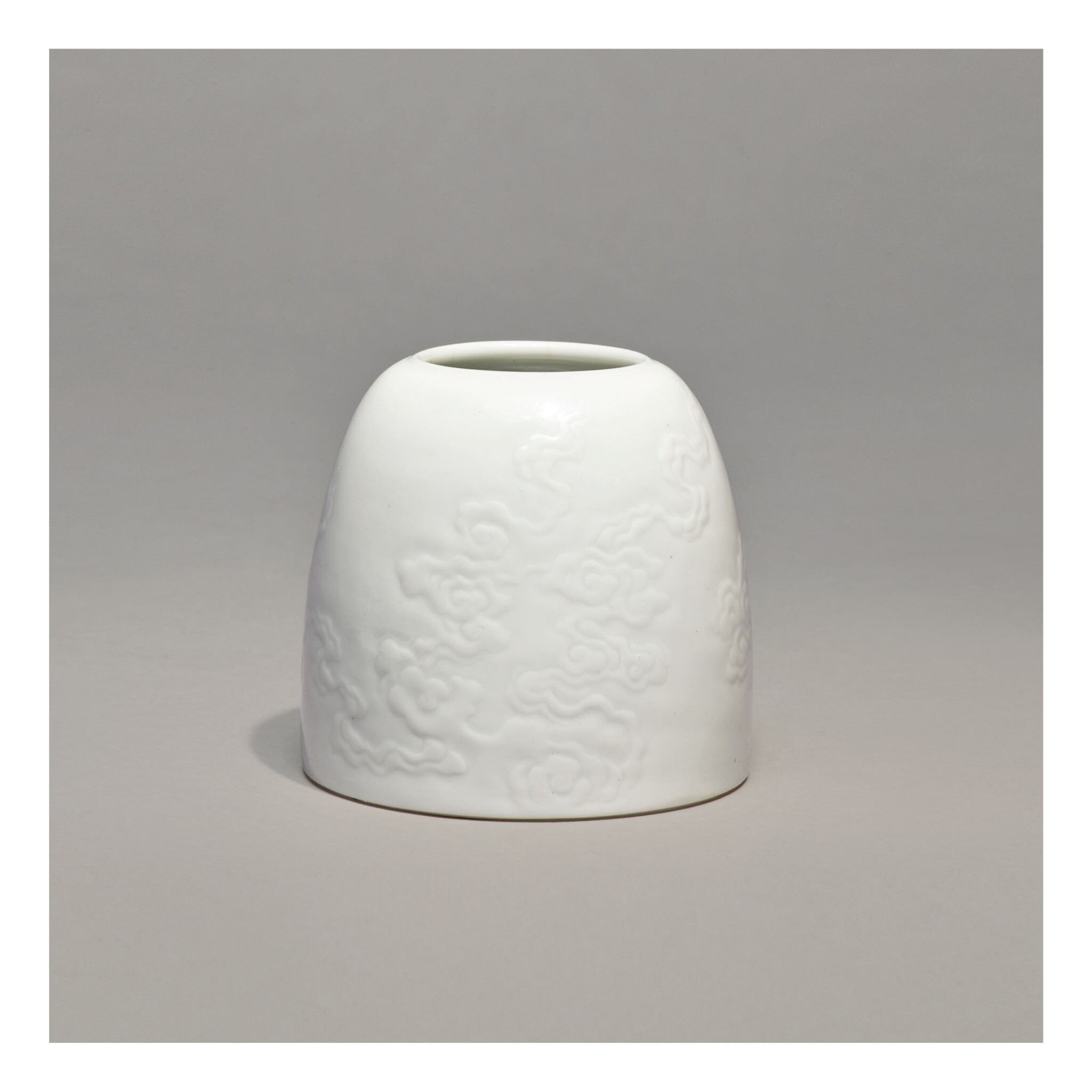View full screen - View 1 of Lot 110. A WHITE-GLAZED CARVED 'BEEHIVE' WATERPOT,  KANGXI MARK AND PERIOD.