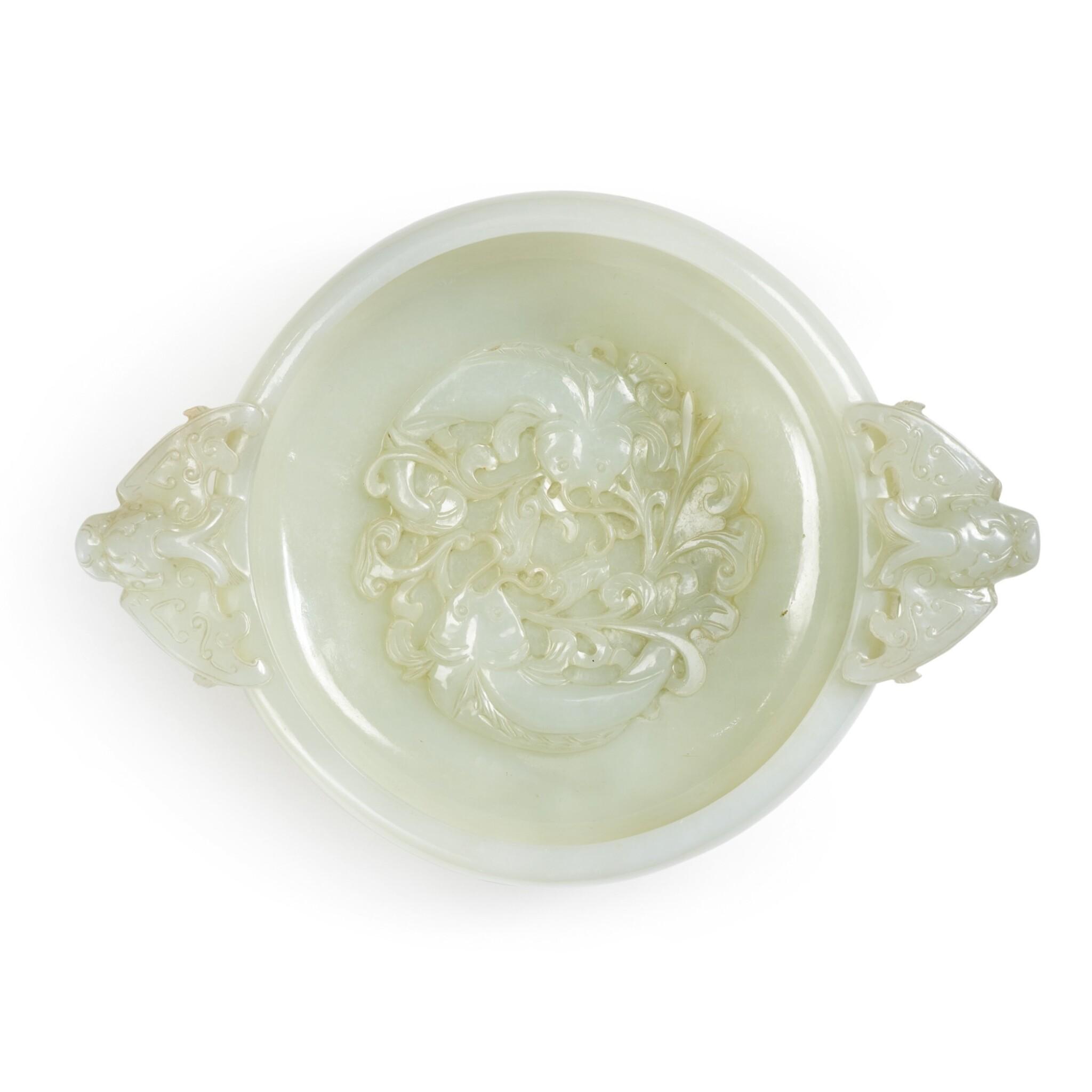 View full screen - View 1 of Lot 7. A white jade marriage bowl, Qing dynasty, 18th / 19th century   清十八 / 十九世紀 白玉雕年年有餘紋龍耳活環洗.