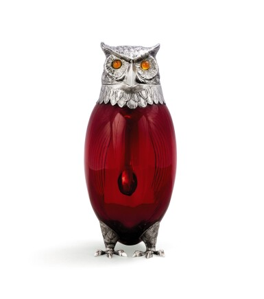 View 2. Thumbnail of Lot 53. A red glass owl decanter with silver head, neck, and feet, Cartier, Paris, 20th century.