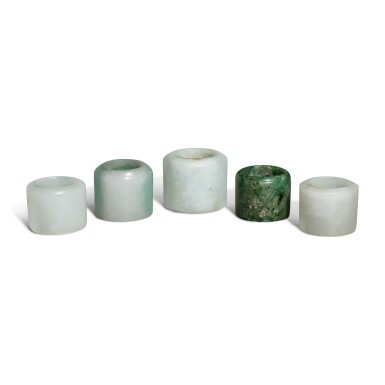 View 2. Thumbnail of Lot 163. Five jade and jadeite archer's rings, 19th / 20th century.