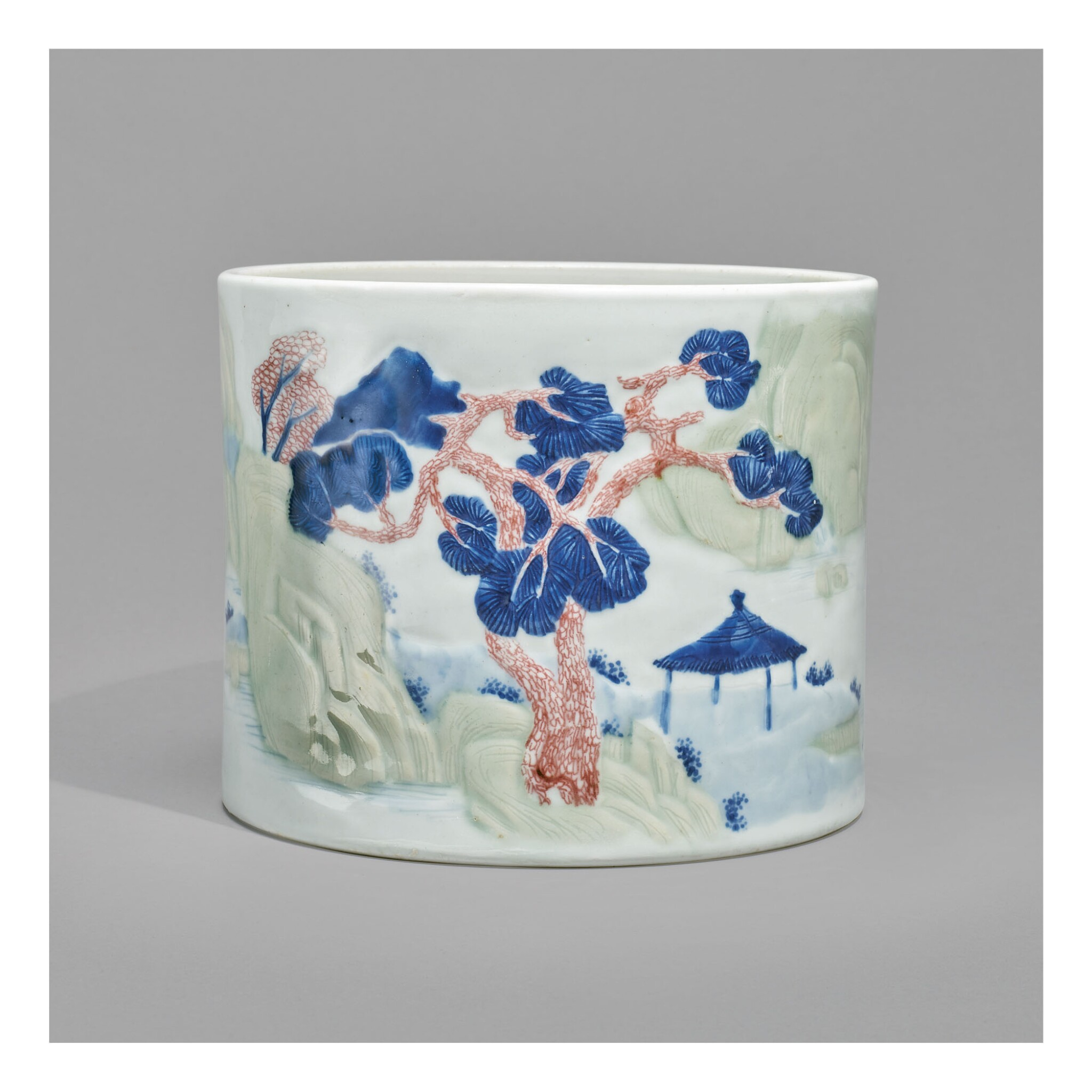 View full screen - View 1 of Lot 125. AN UNDERGLAZE-BLUE, COPPER-RED, AND CELADON-GLAZED 'LANDSCAPE' BRUSHPOT,   KANGXI MARK AND PERIOD.