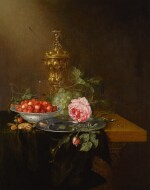PIETER DE RING | Still life with a roemer, a bowl of strawberries and cherries, grapes and a rose