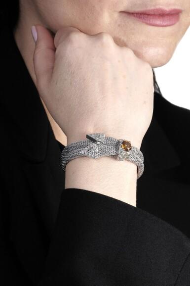 View 4. Thumbnail of Lot 1151. Fancy deep brownish yellowish orange diamond and diamond bracelet.