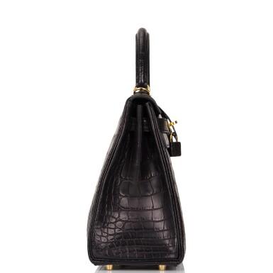View 3. Thumbnail of Lot 44. Hermès Black Retourne Kelly 28cm of Matte Alligator with Gold Hardware.