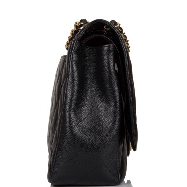 View 3. Thumbnail of Lot 60. Chanel Quilted Maxi Classic Double Flap Bag of Black Caviar Leather with Gold Hardware.
