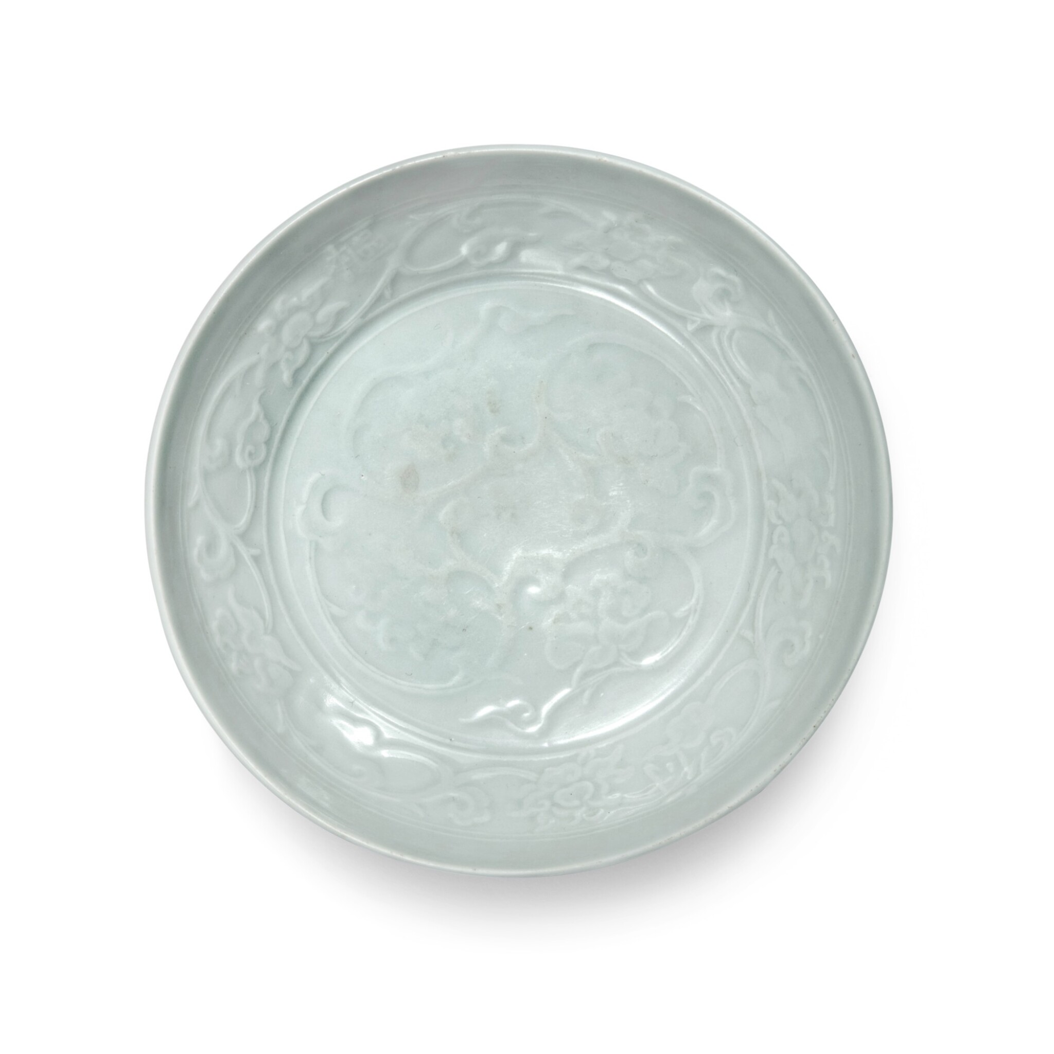 View full screen - View 1 of Lot 91. A molded 'Shufu' white-glazed 'lotus' dish, Yuan dynasty | 元 樞府白釉印花纏枝蓮紋盤.