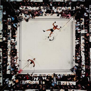 NEIL LEIFER | 'AERIAL OF MUHAMMAD ALI VICTORIOUS AFTER HIS ROUND TWO KNOCKDOWN OF CLEVELAND WILLIAMS DURING THE 1966 WORLD HEAVYWEIGHT TITLE FIGHT AT THE ASTRODOME', HOUSTON, TEXAS, NOVEMBER 14, 1966