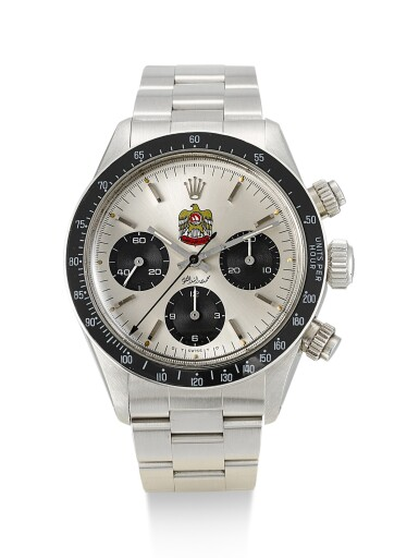 View 1. Thumbnail of Lot 5. ROLEX | DAYTONA, REFERENCE 6263, A STAINLESS STEEL CHRONOGRAPH WRISTWATCH WITH UAE QURAYSH HAWK DIAL, MADE FOR MOHAMMED BIN RASHID AL MAKTOUM, CIRCA 1975.