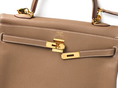 View 3. Thumbnail of Lot 8. KELLY 35 RETOURNE ETOUPE COLOUR IN TOGO LEATHER WITH GOLD HARDWARE. HERMÈS, 2017 .