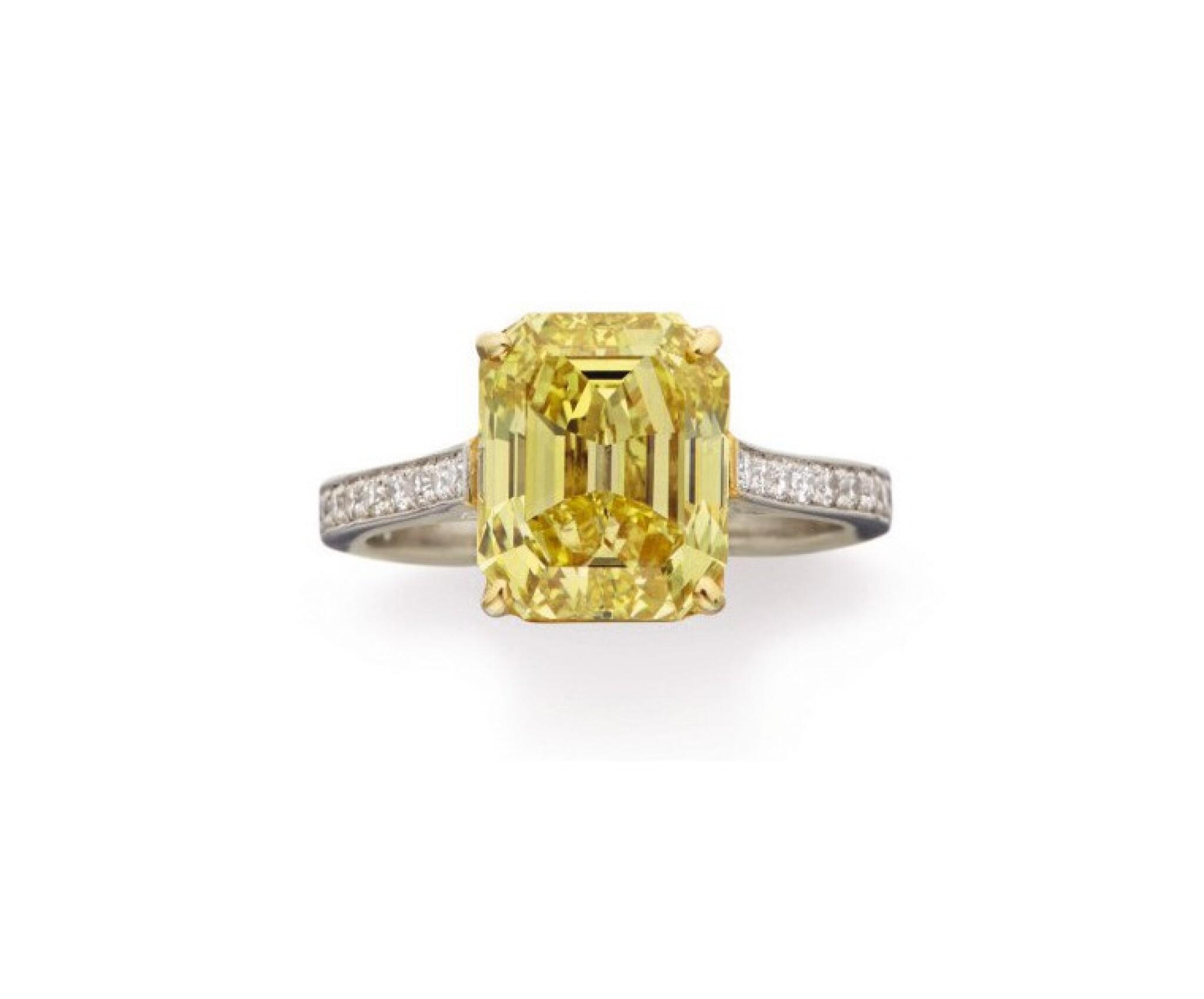 View full screen - View 1 of Lot 80. FANCY VIVID YELLOW DIAMOND AND DIAMOND RING.