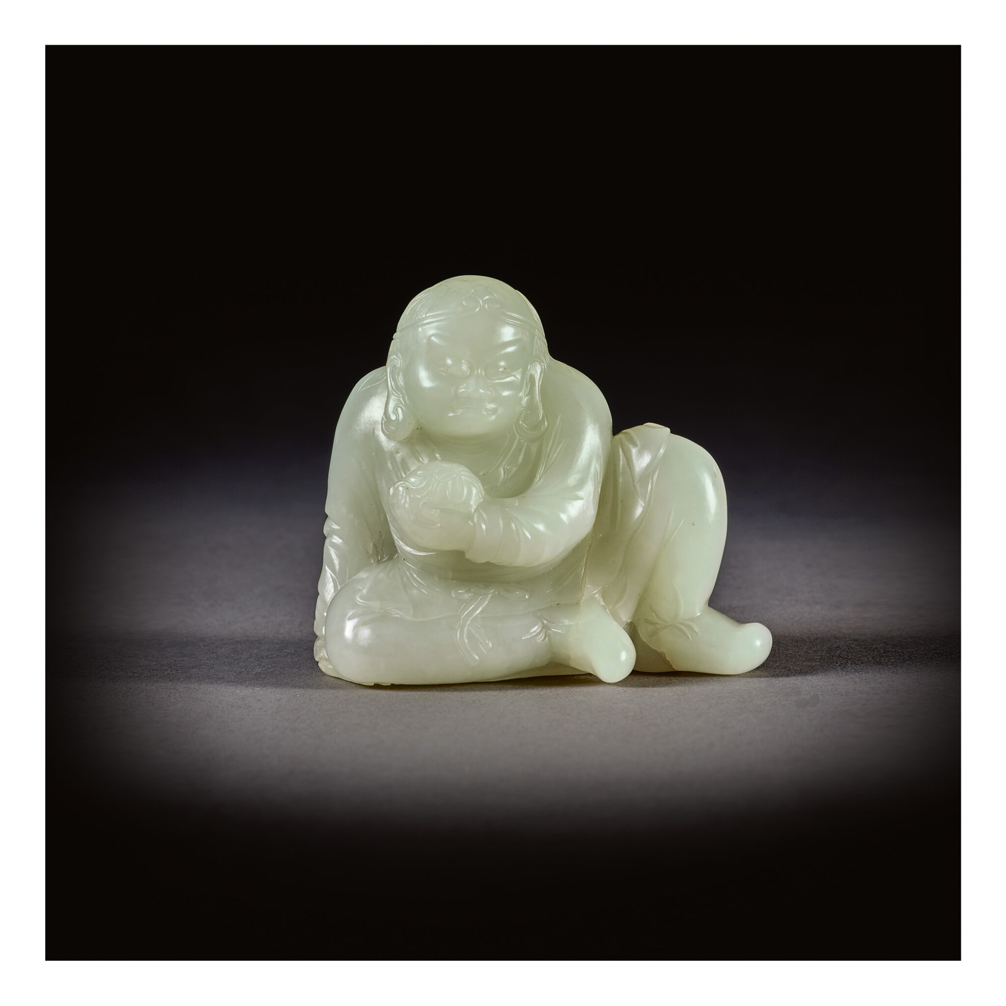 View full screen - View 1 of Lot 208. A PALE CELADON JADE FIGURE OF A SEATED LUOHAN,  QING DYNASTY, 18TH CENTURY.