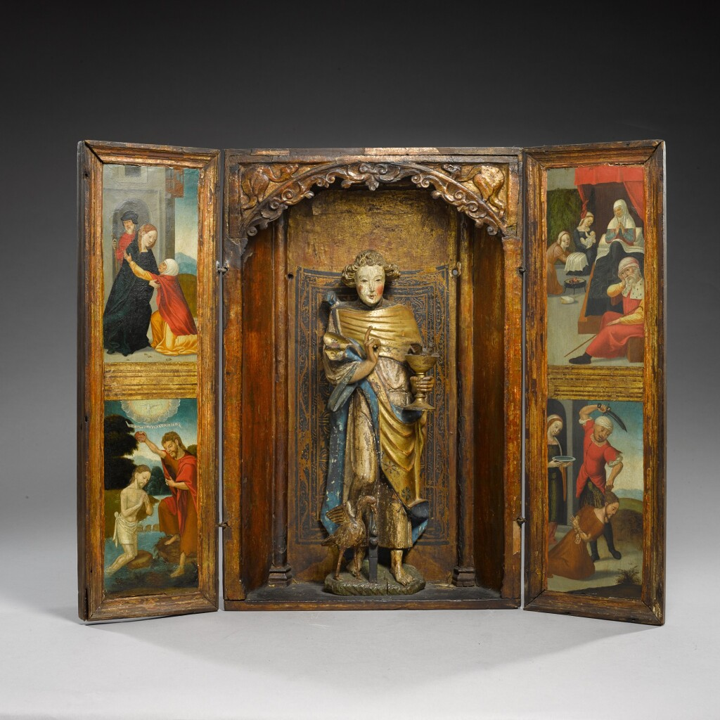 SOUTHERN NETHERLANDISH, PROBABLY MALINES, EARLY 16TH CENTURY | TRIPTYCH CENTRED BY A FIGURE OF SAINT JOHN THE EVANGELIST