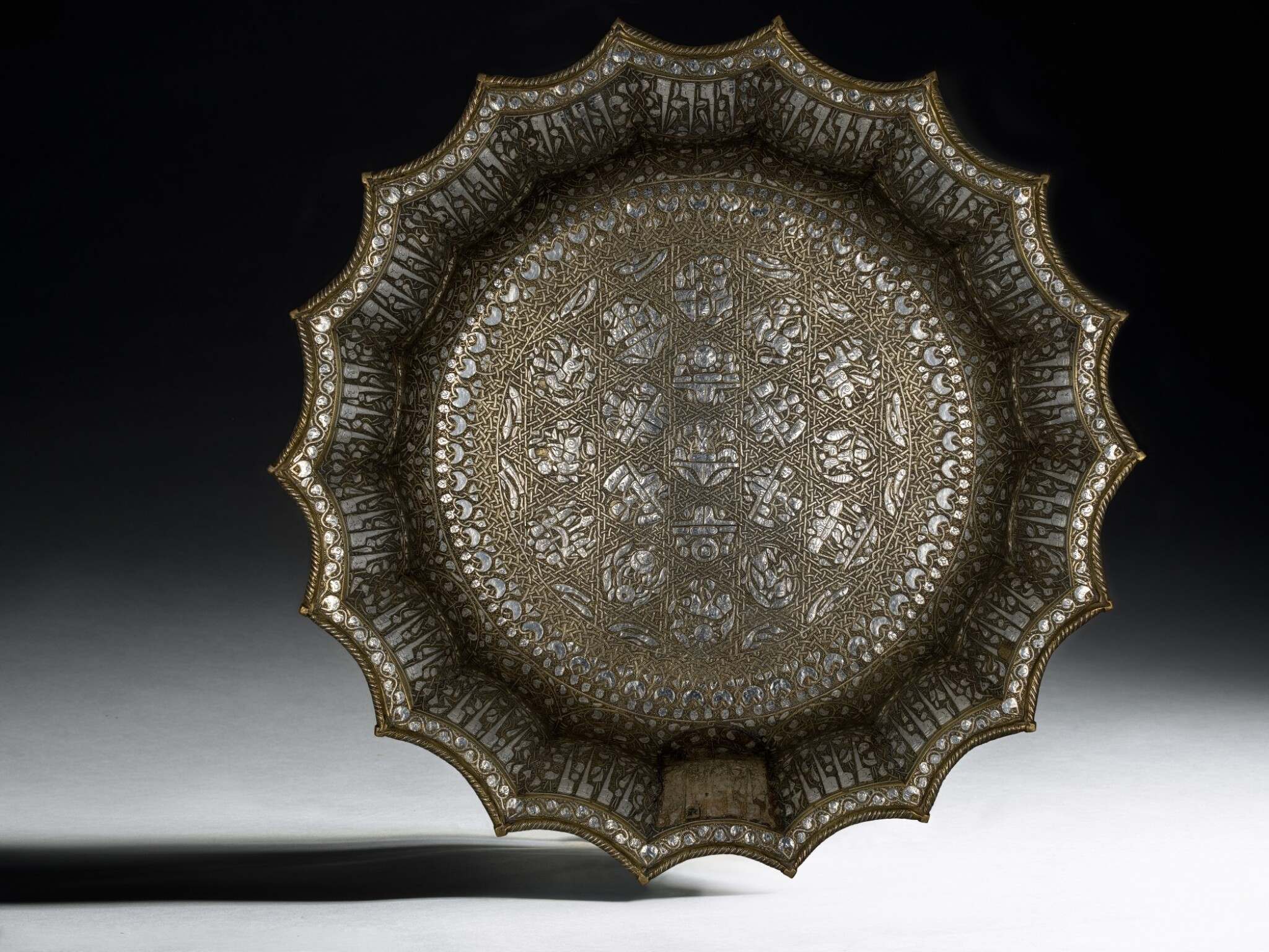 View full screen - View 1 of Lot 74. A rare and important Khurasan silver-inlaid brass basin, probably Herat, circa 1200.