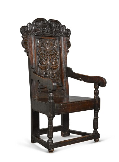 View 2. Thumbnail of Lot 24. A Charles II carved oak panel-back armchair.