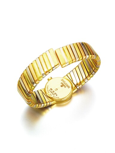 View 4. Thumbnail of Lot 43. BULGARI   REF BB 19 2T A LADY'S TRI COLOR GOLD TUBOGAS CUFF WATCH CIRCA 1985.