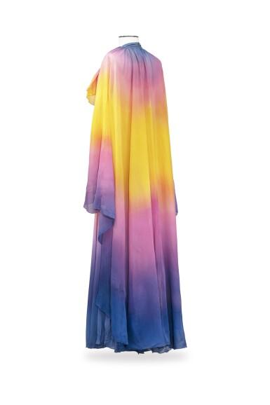 View 2. Thumbnail of Lot 10. Balestra, 1972, Sunbathing dress with pleated collar and matching cape | Robe longue bain de soleil à collerette plissée en mousseline avec cape assortie.