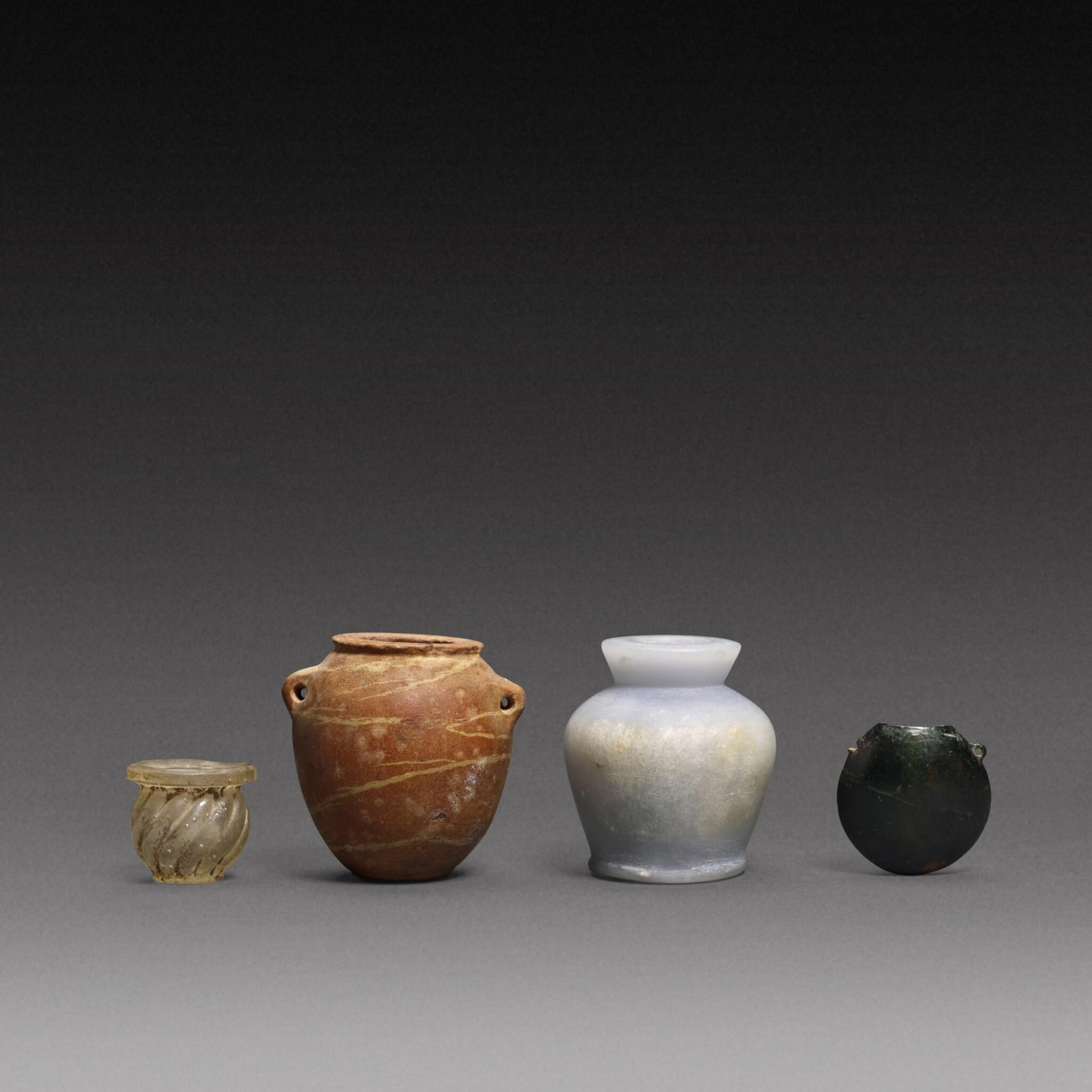 View full screen - View 1 of Lot 70. Four Miniature Vessels, circa 4th millennium B.C./1st Millennium A.D..