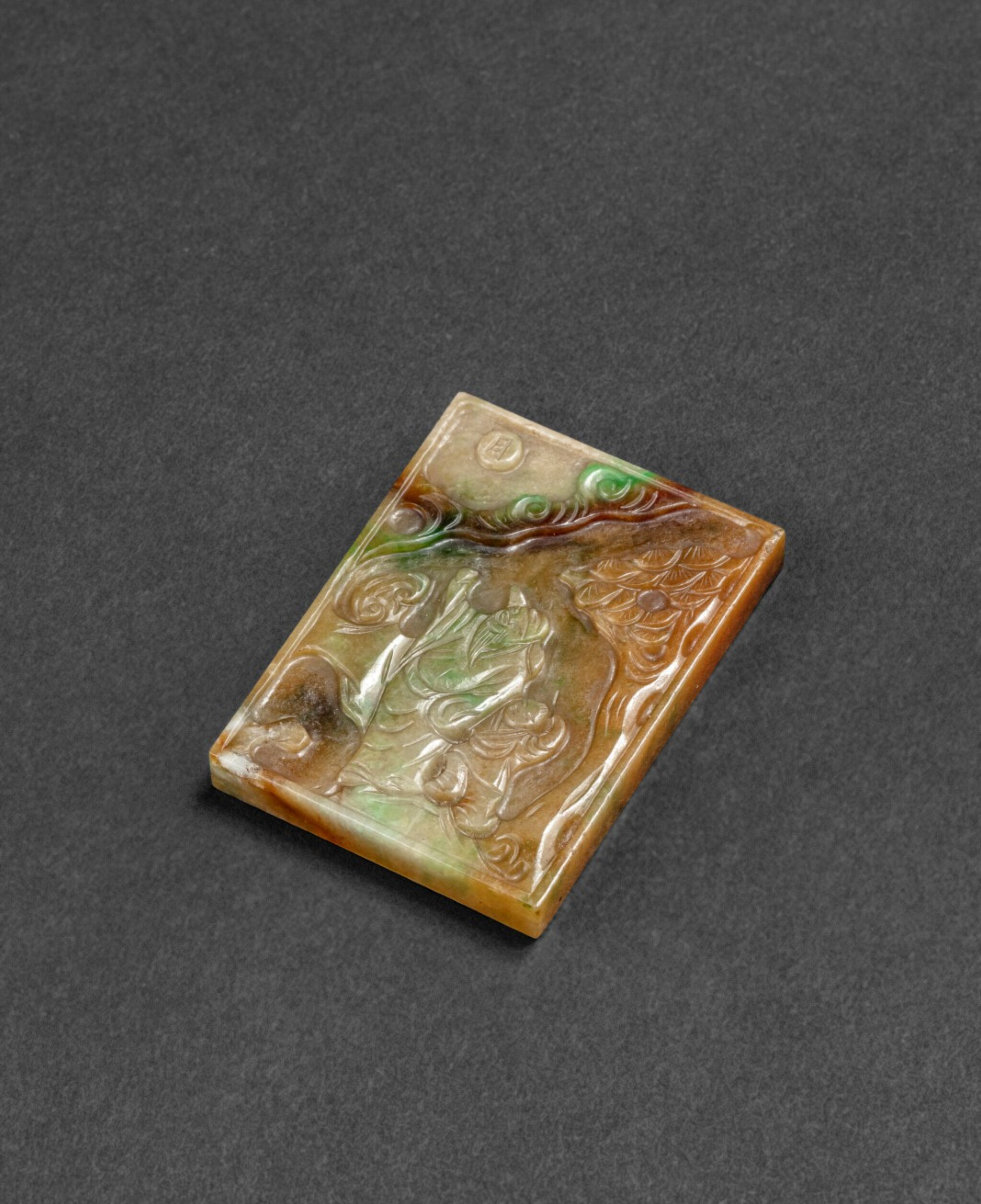 View 1 of Lot 62. Plaque en jadéite sculptée Fin de la dynastie Qing | 清晚期 翠玉雕人物故事圖牌 | A russet and apple-green 'scholar and boy' jadeite plaque, late Qing Dynasty.