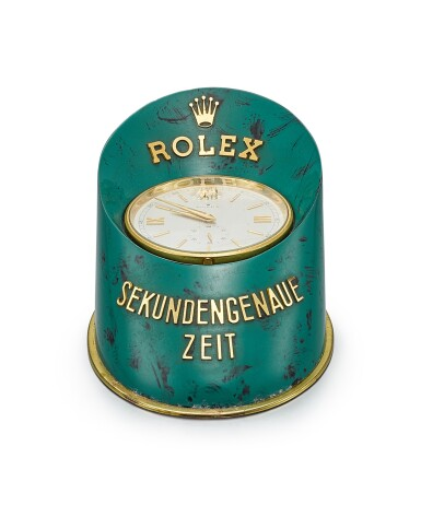 ROLEX | A GILT BRASS AND PAINTED HOOF-SHAPED DISPLAY DESK CLOCK WITH STOP FEATURE AND ORIGINAL WOODEN BOX, CIRCA 1960