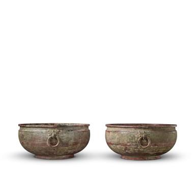 View 4. Thumbnail of Lot 16. A pair of archaic bronze water basins (Jian), Eastern Zhou dynasty, late 6th - early 5th century BC   東周 公元前六世紀末至五世紀初 青銅交龍紋鋪首耳鑒一對.