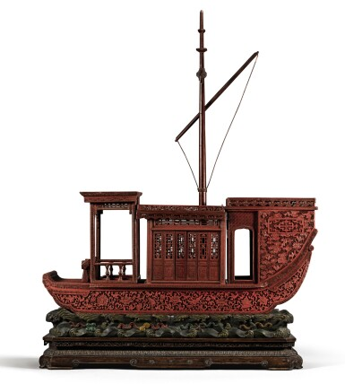 View 1 of Lot 143. A RARE AND LARGE CARVED CINNABAR LACQUER BOAT-SHAPED INCENSE BOX QING DYNASTY, QIANLONG PERIOD | 清乾隆 剔紅八吉祥紋畫舫式香盒.