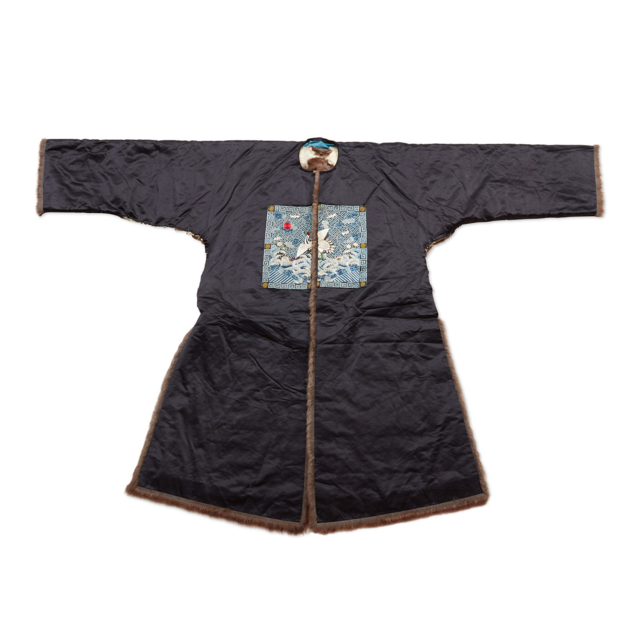 View full screen - View 1 of Lot 237. A fur-lined navy silk first-rank civil official winter robe, Late Qing dynasty | 清末 石青色綢內襯皮一品補服.